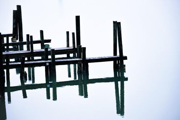 Glassy calm morning on the Laguna Madre in south Texas These docks look like the space station