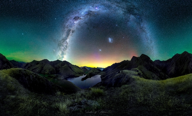 Panorama of Milky Way arching over Moke Lake Queenstown with Aurora Australis and green Airglow  south_of_home
