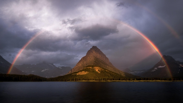 Rainbow bright Here a pretty picture I shot about a week ago now while visiting Glacier National Park for the first time Have a happy Friday evening and weekend OC  IG wwwinstagramcomjohn_perhach_photo