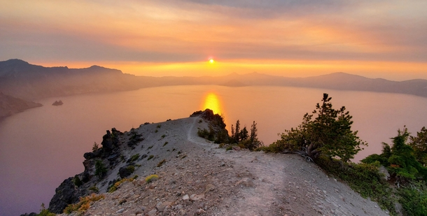 x A hazy sunset on a happy lil ridge in crater lake oregon The caldera was Smokey from the recent wildfires