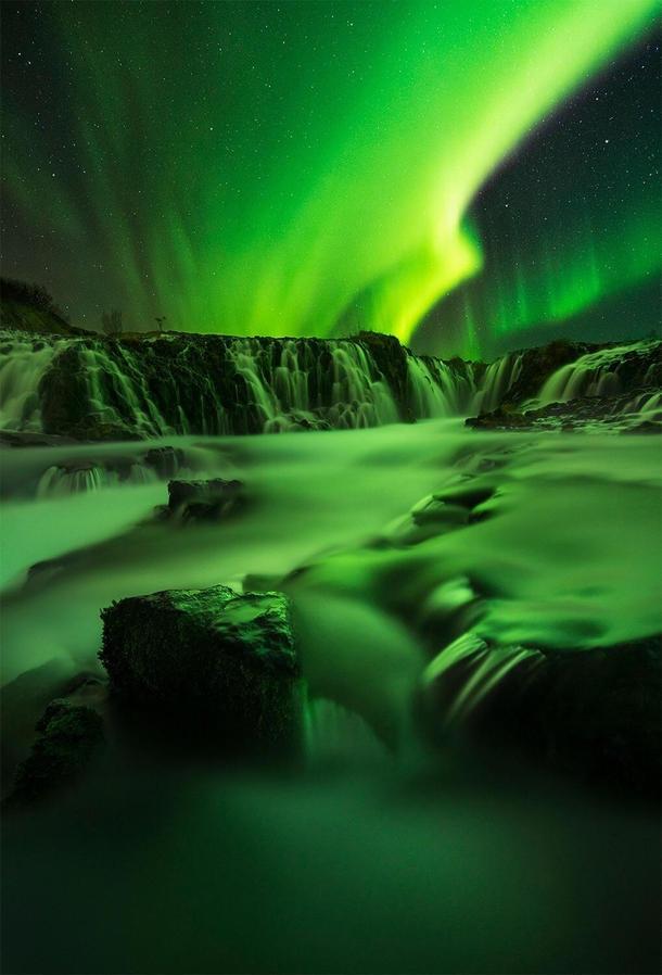 A brief yet intense display of the aurora over Bruarfoss Iceland OC x williampatino_photography