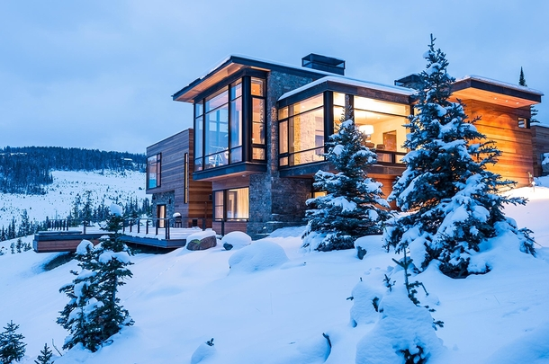 A brightly lit modern home in the middle of the Montana wilderness