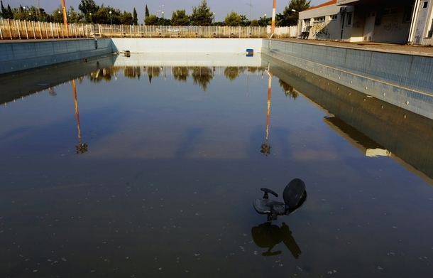 A chair stands in a deserted swimming pool at the Olympic Village in the town of Thrakomakedones north of Athens