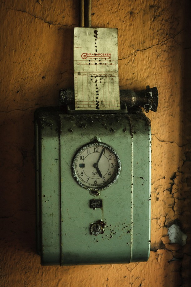 A clock card machine from an iron factory that has been abandoned for years Finland - Photorator