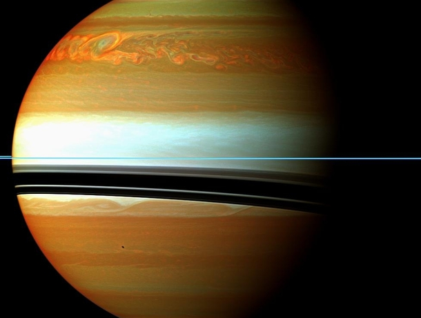 A fierce storm system on Saturn wrapped around the planet at  degrees north latitude and stretching about  miles  kilometers in circumference