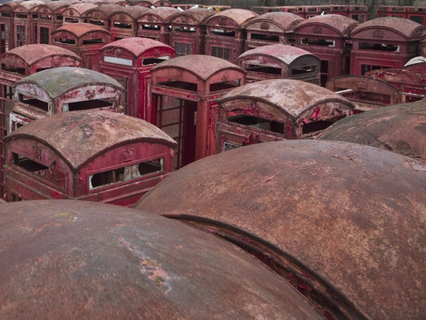 A graveyard of red telephone boxes in Carlton Miniott northern England  Photograph by Nicolas Ritter