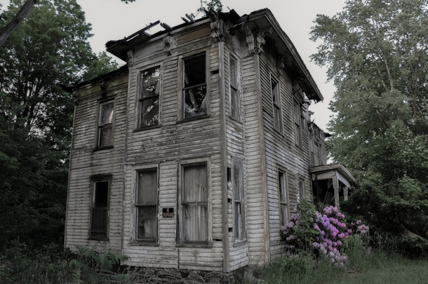 A house in Buffalo New York vacant since the owners suicide in   Photo by Seph Lawless