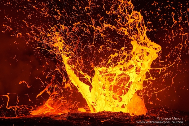 A huge lava bubble explodes sending sheets of expanding molten rock airborne HI Photo by Bruce Omori