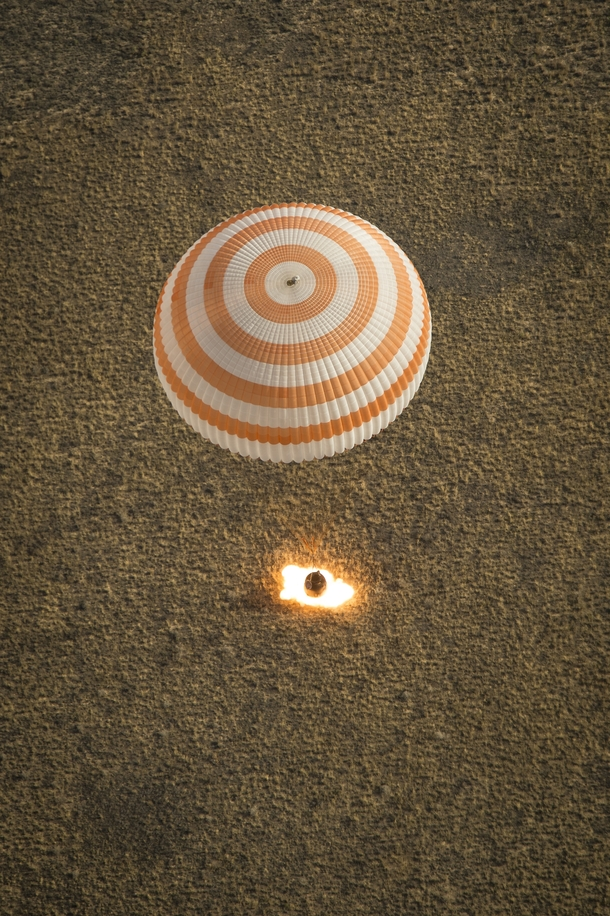 A landing on planet Earth for Expedition  from the ISS with parachute deployed and retro-rockets blazing three days ago