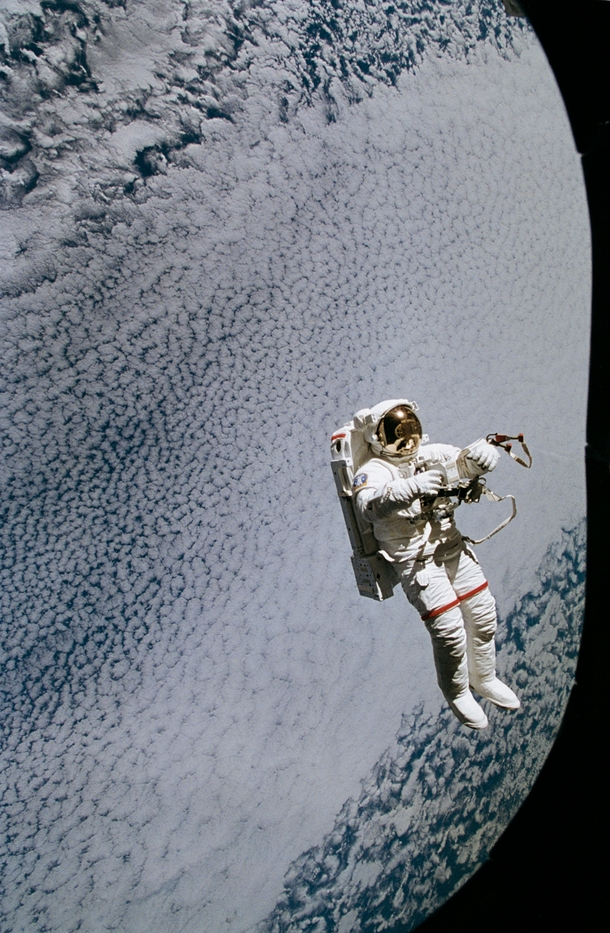 A member of the STS  mission floats freely as he tests the new Simplified AID for EVA Rescue SAFER system on September