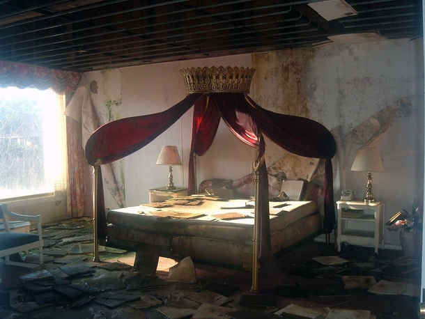 A once-grand bed in an abandoned lodge by original on flickr