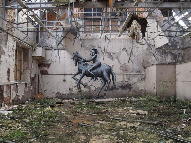 A seriously old and abandoned school with a bit of sprucing up by British street artist Phlegm