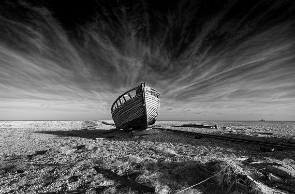 A shipwreck well away from water near Dungeness UK  by garthursnapshot