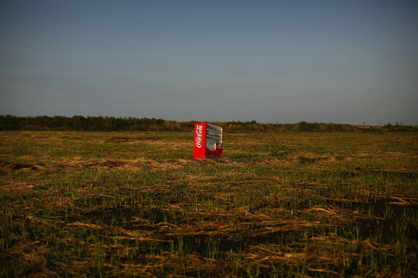 A vending machine brought inland by the tsunami in an abandoned rice field in Fukushima
