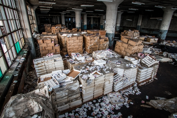 A very large collection of collectible sports cards in an abandoned Detroit car factory