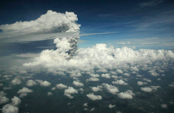 A view from a domestic flight from Denpasar to Yogyakarta that was subsequently diverted to Surabaya airport shows a plume of gas and ash billowing some  km six mi high from Mount Merapi during an eruption on November