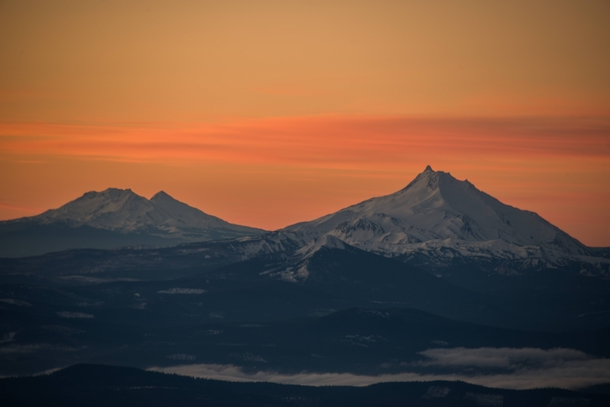 A view of Mt Jefferson North Sister and Middle Sister from Mt Hood Oregon before the sunrise  Photo by Jason George