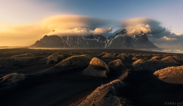 A winter sunset with some lenticulars above that mountain Stokksnes Iceland