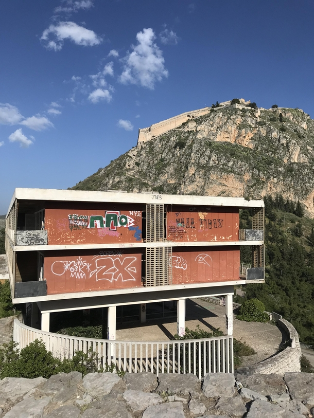 Abandoned hotel in Nafplio Greece under the shadow of the Palamidi fortress