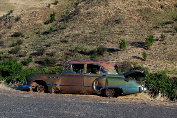 Abandoned s car on Wawawai Grade Road near the Snake River in Eastern Washington