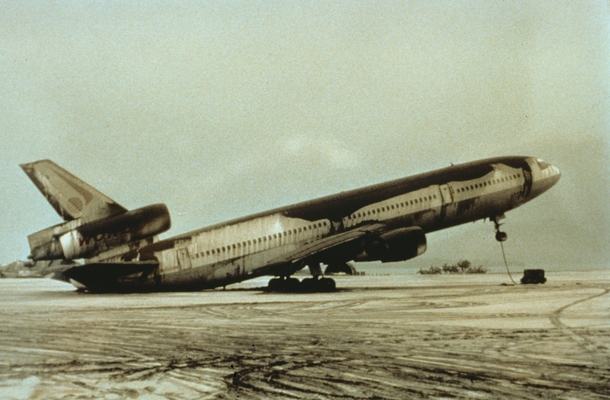 An abandoned World Airways DC- airplane sitting on its tail because of the weight of wet volcanic ash from the  Mount Pinatubo eruption