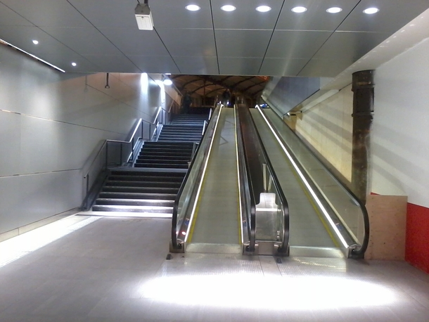 An often forgotten type of infrastructure - Pedestrian infrastructure Two new roll pads next to a staircase the renewed entrance to Amsterdam Central Metro station The Netherlands