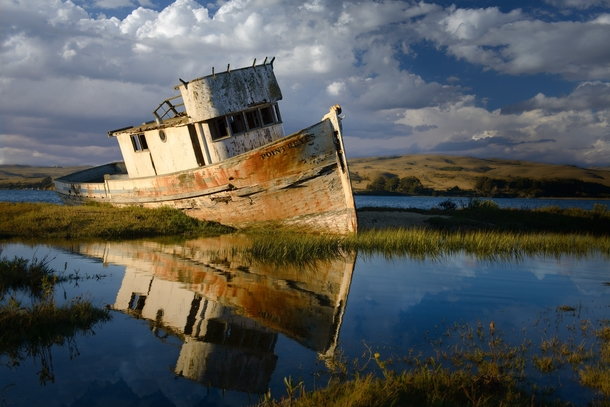 An old rusty ship in Tomales Bay California  by Gideon Chen