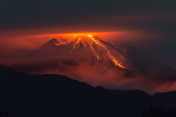 An ominous sight the eruption of the volcano Reventador in the eastern Andes of Ecuador  photo by Jeff Cundith x-post rHellscapePorn