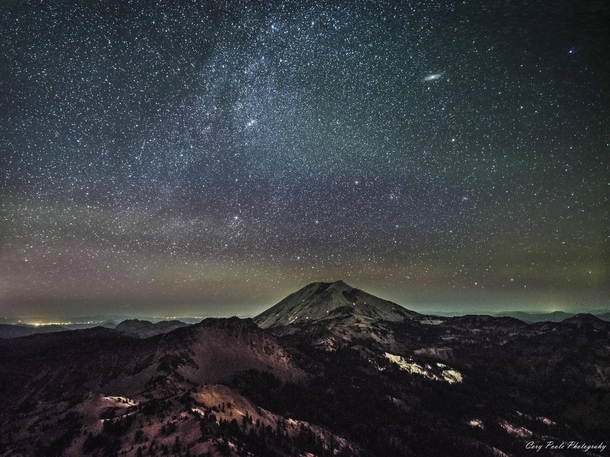 Andromeda Galaxy and part of the disc of the Milky Way rising over Lassen Peak in Northern California