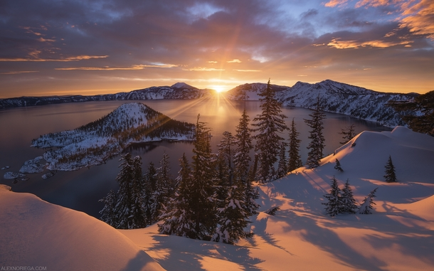Arclight - A Winter Sunrise at Crater Lake Oregon by Alex Noriega