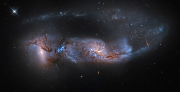 Arp  a strongly distorted pair of galaxies is seen about  million years after their close encounter The havoc wreaked by their collision is detailed in their twisted streams of gas and dust a chaos of massive star formation and a tidal tail stretching for