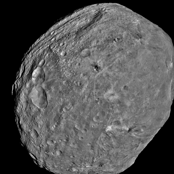Asteroid Vesta It is the brightest most visible dwarf planet from earth Notice one side is heavily created the other side not so Notice too the stretch marks at the top believed to be caused by a massive impact NASAx