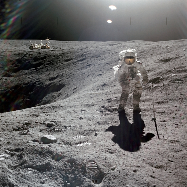 Astronaut Charles M Duke Jr lunar module pilot of the Apollo  lunar landing mission is photographed collecting lunar samples at Station no  during the first Apollo  extravehicular activity at the Descartes landing site