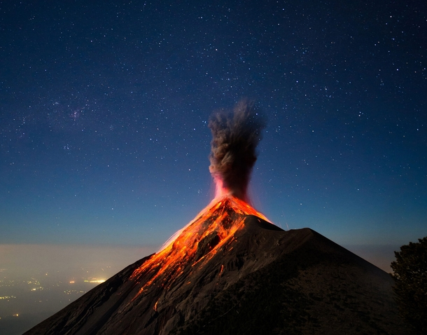 At around  am we awoke to the sound of a breath-stealing explosion I scrambled to the camera just in time to capture a moonlit and lava-covered Fuego as it put on this beautiful display of activity and power - Volcn de Fuego Guatemala  Photo by Andrew She