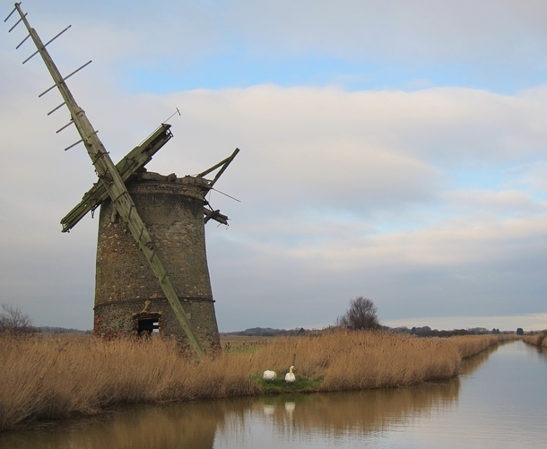 Bograve Mill is an abandoned windpump in Norfolk England and was in use from  to roughly  Its westward lean gave rise to a myth that a furious Devil tried to foil Brograves drainage efforts by blowing it down bonus swans