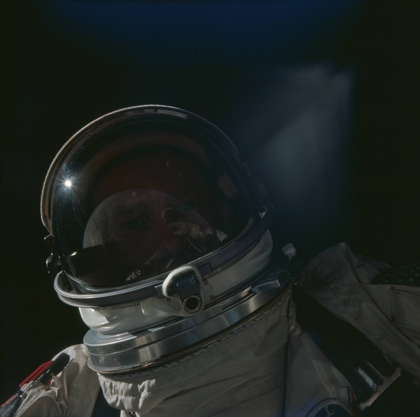 Buzz Aldrins self-portrait during Gemini  with the Earth reflecting off his visor  November