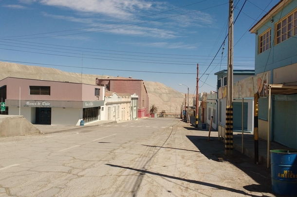Chuquicamata Chile pop  was abandoned in  due to the increasing proximity of waste material from the Chuquicamata copper mine and health concerns about dust and toxic gasses  years later it remains virtually untouched Eventually it will be buried beneath