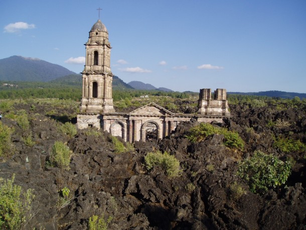 Church spires projecting from the lava which buried San Juan Parangaricutiro Mexico