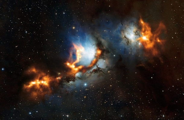Clouds of cosmic dust threaded through the reflection nebula Messier  like a string of pearls