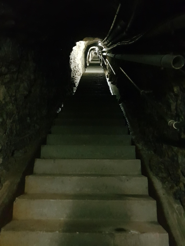 Connection tunnel of one of our local artillery fortificationsmaintenance and living level to high level cannon bunkersabandonded in the nineties but still fully functional Imagine getting up for your  hour shift an going up  steps with your gear after br