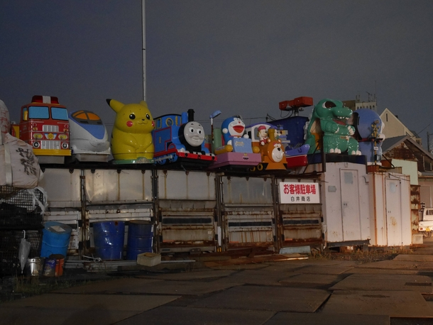 Decommissioned kids rides on a scrapyard Japan
