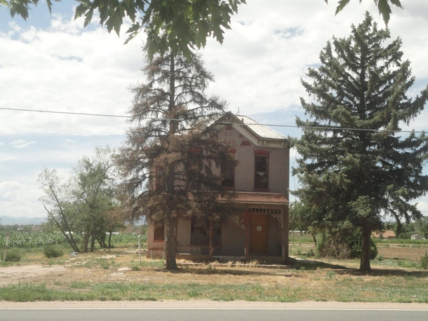 Dilapidated Boarded-Up Farmhouse Denver CO