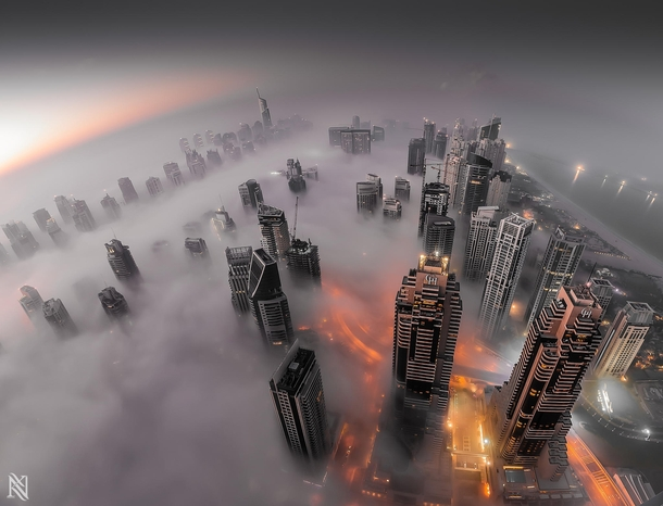 Dubai in the fog  by Karim Nafatni