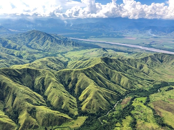 Flying over the Markham Valley Papua New Guinea via rotary wing in support of US DoD agency DPAA Pretty near