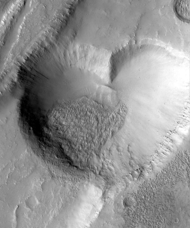 From Mars With Love The heart-shaped pit on Mars is about  kilometers  miles at its widest  NASAJPLMSSS