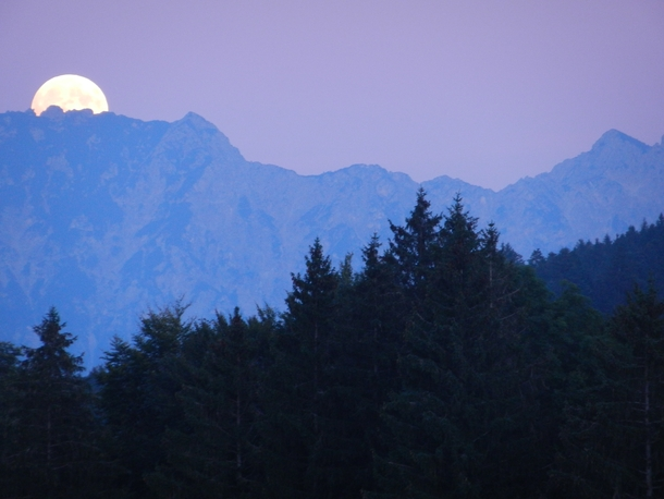 Full moon rising over the mountains in Wildhaus Switzerland  by Eliza Harris