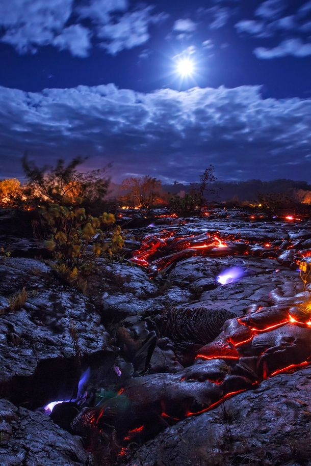 Hawaii USA Seeping methane burns a bright blue as lava advances through a forest  Decomposing vegetation beneath the molten flow creates extremely volatile pockets of the highly flammable gas and when ignited by the intense heat powerful explosions can re