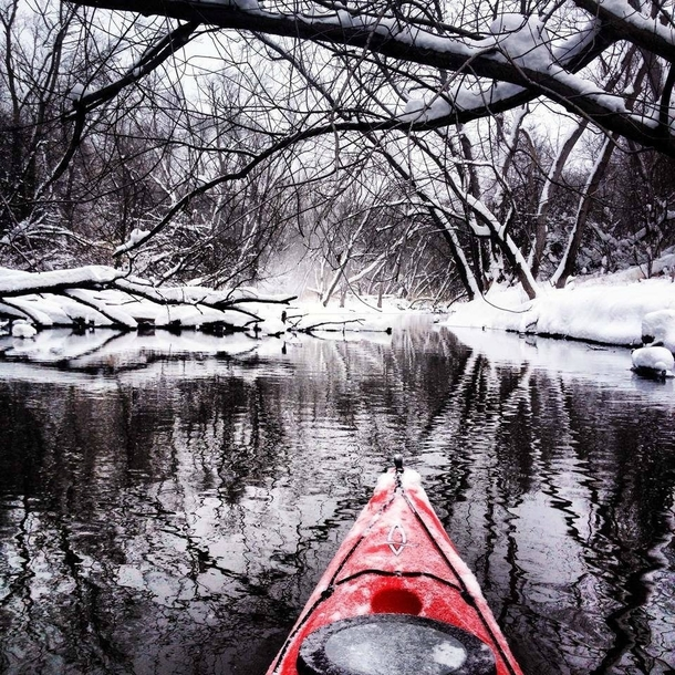 Hello winter enthusiasts I posted a winter kayaking pic on this sub last year and you guys seemed to really like it I took this picture a few months later while kayaking during a light snowfall Looking forward to the winter paddling season