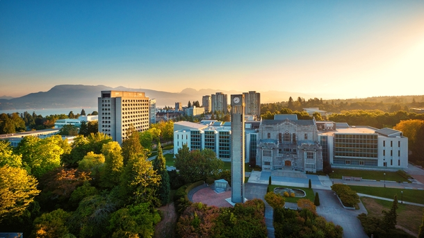 High-res photo of the University of British Columbia looking northeast past Main library and across Burrard Inlet at dawn