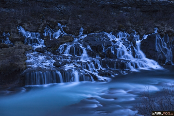 I was looking for the northern lights last week but it was too bright even at  am Disappointed I shot this waterfall instead Hraunfossar at twilight giving it a surreal look Iceland